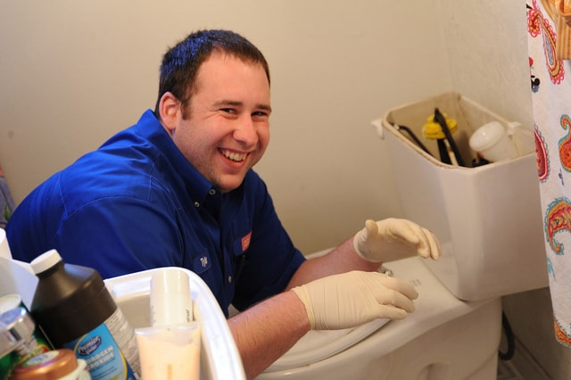 happy plumber smiling